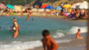 Blurred people enjoying themselves at the beach in slow motion stock video