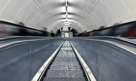 Blurred people on escalator at rush hour. Royalty Free Stock Photo