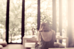 Blurred people reading a books in public library. In vintage color tone Royalty Free Stock Image