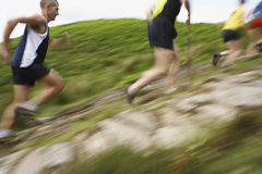 Blurred People Running On Track. Side view of blurred group of people running on track Stock Photos