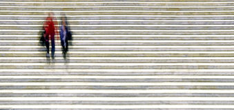 Blurred people in staircase Royalty Free Stock Photos