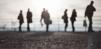 Blurred people standing in bright sky Stock Photography
