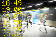 Blurred people on subway platform Stock Photos