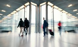 Blurred people at a trade fair hall Royalty Free Stock Photo