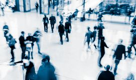 Blurred people at a trade fair hall Royalty Free Stock Image