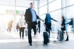 Blurred people at a trade fair hall Stock Image