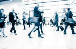 Blurred people at a trade fair hall Royalty Free Stock Photos