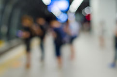 Blurred people at train station Stock Image