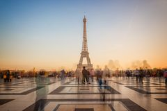 Blurred people on Trocadero square admiring the Eiffel tower at sunset, Paris France Royalty Free Stock Photography