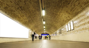 Blurred people on tunnel Stock Images
