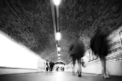Blurred people on tunnel Royalty Free Stock Photos