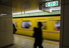 Blurred people in underground subway in Japan with under exposure style Royalty Free Stock Photography