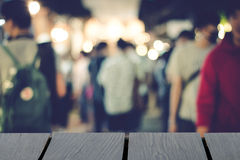 Blurred people walking background and wooden table on font. mock Stock Photo