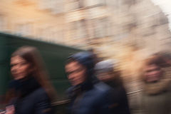 Blurred people walking in the city Stock Image