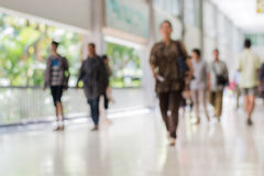 Blurred People Walking In The Building Royalty Free Stock Image