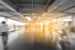 Blurred people walking on skywalk under electric train station in Bangkok City,. Thailand - City Concept stock images