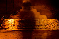 Blurred person silhouette in dark. Alley Royalty Free Stock Photo