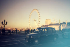 Blurred photo of London traffic at rush hour on Westminster Brid. Ge at sunset, London Eye in the background, London, UK Royalty Free Stock Photo