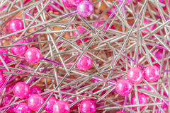 Blurred photo of pink sewing pins in the box. Stock Images
