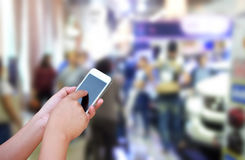 Blurred photo and smartphone on shopping mall blur background wi. Th bokeh Stock Image