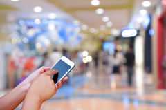 Blurred photo and smartphone on shopping mall blur background wi. Th bokeh Stock Images