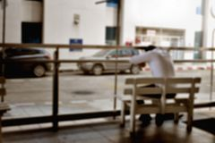 Blurred photo of tired man sitting on the bench royalty free stock images