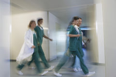 Blurred Physicians Rushing Through Hospital Corridor Stock Photography
