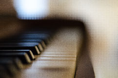 Blurred Piano Keys. Blurred keys of an old piano inside a home Royalty Free Stock Photo
