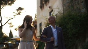 Blurred picture of luxuriant couple walking around backyard stock video