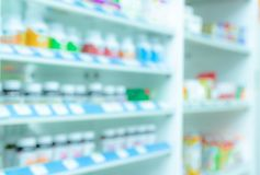 Blurred picture of medicine shelf in drug store. Pharmacy shop interiors. Pharmaceutical products in drugstore. Medical retail. Shop. Pharmacy in hospital royalty free stock photo