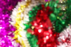 Blurred picture red green and purple bokeh colorful glittering for merry christmas and happy new year festival background design. The blurred picture red green royalty free stock photography