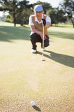 Blurred picture of sportsman analysing the field. On a golf course Royalty Free Stock Photo