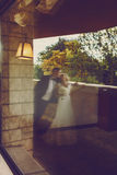 A blurred picture of a wedding couple standing on the balcony.  royalty free stock photography