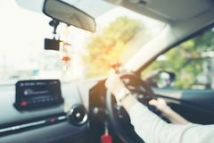 Blurred picture of women driving a car on the road, female driver Stock Photography