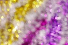Blurred picture yellow gold and purple bokeh colorful glittering for merry christmas and happy new year festival background design. The blurred picture yellow stock photography