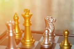 Blurred players out of focus in chess battle for business compet Royalty Free Stock Photo