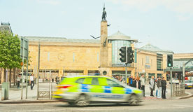 Blurred police car in city center Royalty Free Stock Images