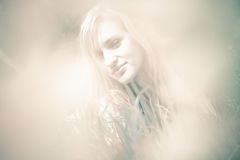 Blurred portrait of beautiful blonde woman Royalty Free Stock Image
