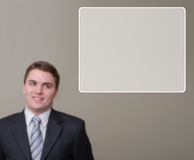 Blurred Portrait of Happy Young Businessman with Text Box. Happy Young businessman blurred in background, with textbox in upper right of image royalty free stock image