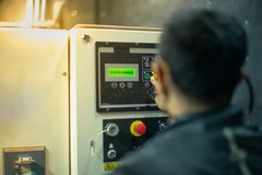 Free Blurred Portrait Of Technician Doing The Preventive Maintenance In The Control Room. Workers Monitoring The Status Of Electronic Royalty Free Stock Photography - 134396877