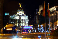 Blurred rays of traffic lights on Gran via street, main shopping street in MAdrid. At night. Spain, Europe Royalty Free Stock Photography