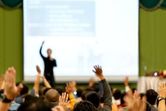 Blurred of rear view Audience in conference hall or seminar room. Speaker are brainstorming, motivational speech at