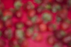 Blurred red background with green spots. Royalty Free Stock Image