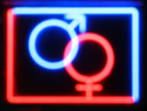 Blurred red and blue sex shop neon sign stock photo