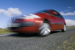 Blurred red car. On the mountain road. Dartmoor, Devon, UK Stock Image