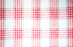Blurred red checkered fabric Stock Images