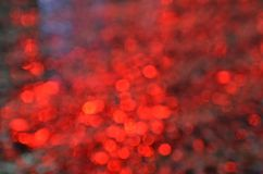 Blurred red circles background. Abstract background of red unfocused light circles stock photography