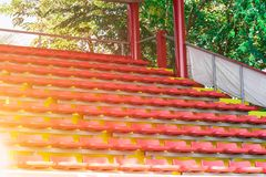 Blurred red empty stadium seats in arena. Concept sport day for kids Stock Image