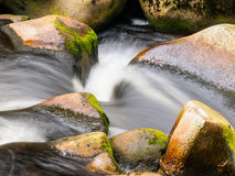 Blurred river stream detail. Of wild rocky mountain river. Silky effect. Motion rendition effect. Slow shutter speed effect. Long exposure effect Stock Photos