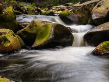 Blurred river stream detail. Of wild rocky mountain river. Silky effect. Motion rendition effect. Slow shutter speed effect. Long exposure effect Royalty Free Stock Photo